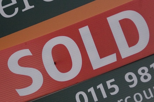 red sold sign