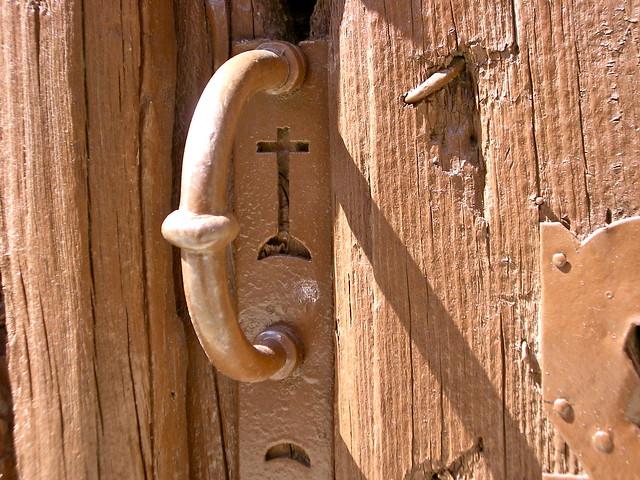 Crur no tirador da porta, en Urueña