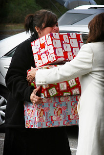 UTC Alumni Office staff Christine Lee and Jayne Holder helping to transport the gifts from the cars to the drop off location. It took six packed cars to transport all of the gifts. | by UT-Chattanooga