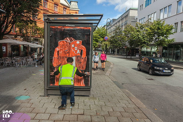 Adbusting with street artist NDA on the streets of Stavanger, Norway