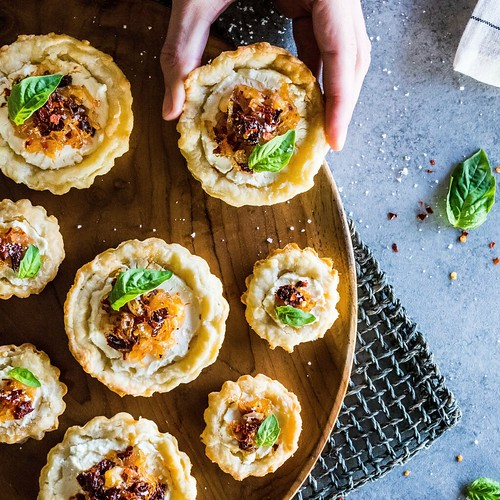 goat cheese tarts with sun-dried tomatoes and caramelized shallots