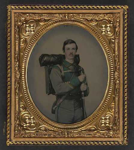 "[Unidentified soldier in Confederate uniform of Co. E, ""Lynchburg Rifles,"" 11th Virginia Infantry Volunteers holding 1841 ""Mississippi"" rifle, Sheffield-type Bowie knife, canteen, box knapsack, blanket roll, and cartridge box] (LOC) 