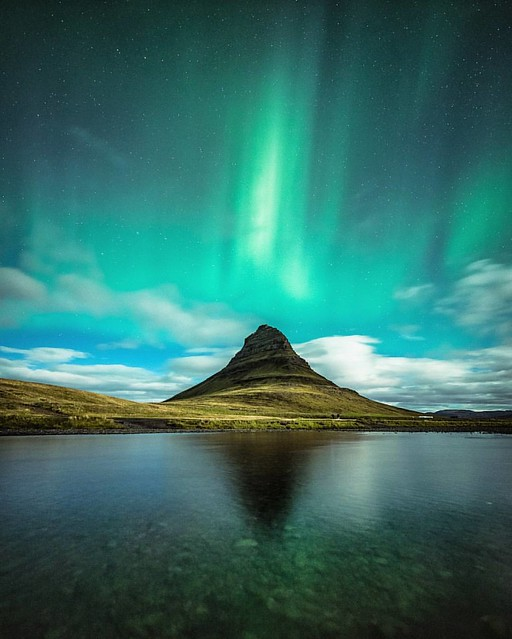 Flaming Kirkjufell 🔥There was one aurora shot i definately wanted to get from Iceland and it was a reflection shot of Kirkjufell and the northern lights. Well on our last night it friking happened!  😍 Dreams can come true :stuck_out_tongue