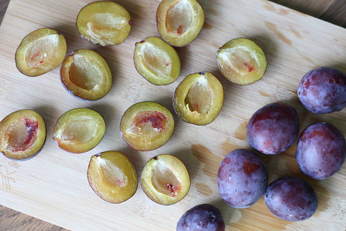 halved pitted plums