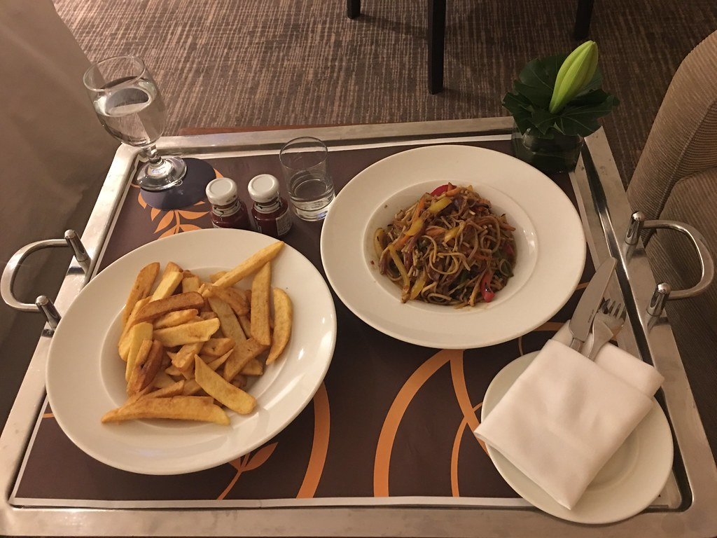 vegetarian noodles and french fries ordered with vodka