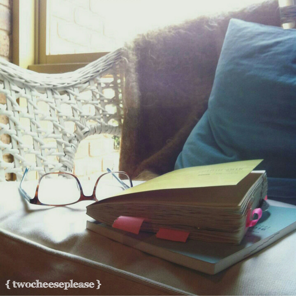 Jan-June and July-Dec hobonichi journals sitting on a cane chair with reading glasses and a blanket