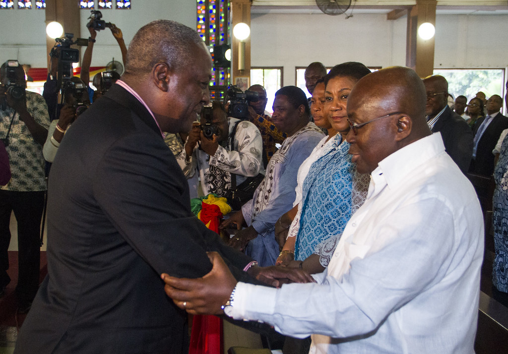 President John Dramani Mahama interacting with Nana Akufo Addo, former presidential candidate of the NPP