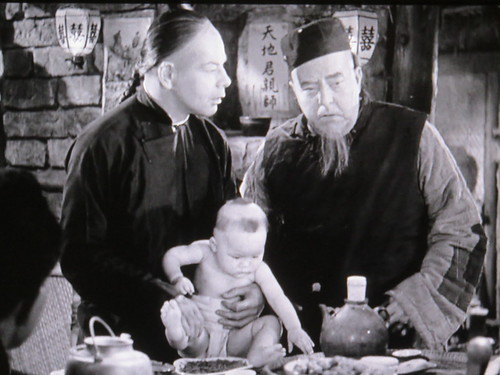Paul Muni, Walter Connolly in THE GOOD EARTH