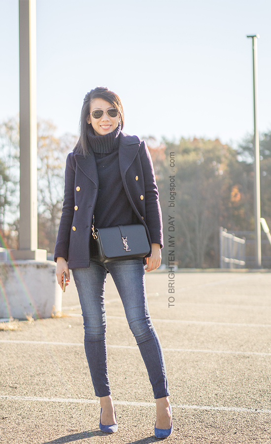 navy peacoat with gold buttons, navy turtleneck tunic sweater, black crossbody bag, skinny jeans, blue suede pumps