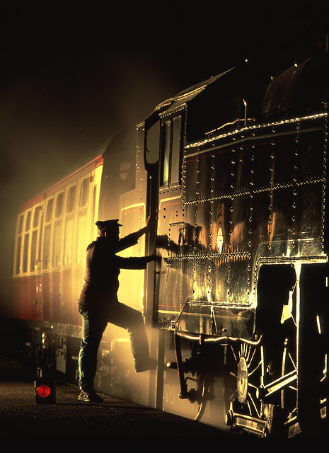 Fireman mounting his loco' in golden light