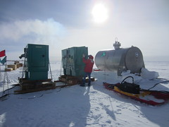 Jay Johnson performing a generator check at the South Pole Ice Core field site