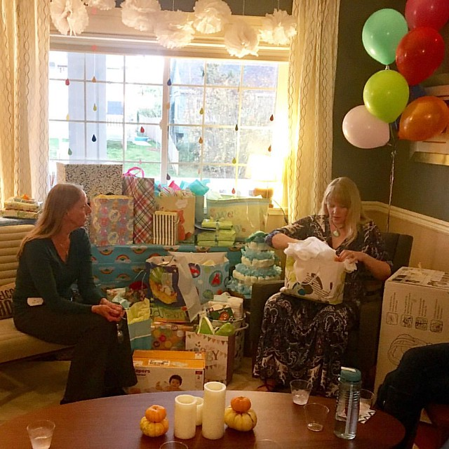 Opening a pile of presents for Baby M. at my shower today. What an amazing turnout of wonderful women!