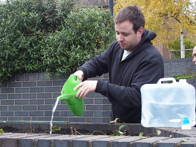 Mark from GoGreen Taxis watering