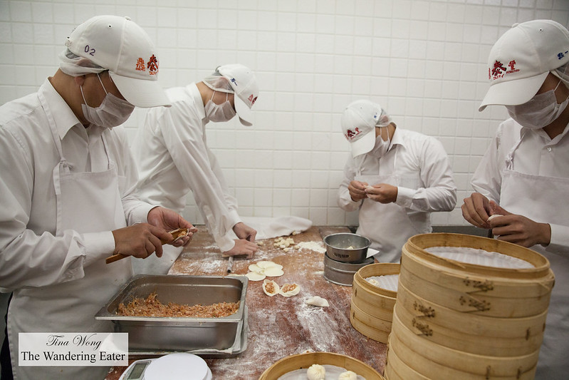 In the Kitchen: Employees pleating the famous pork soup dumplings