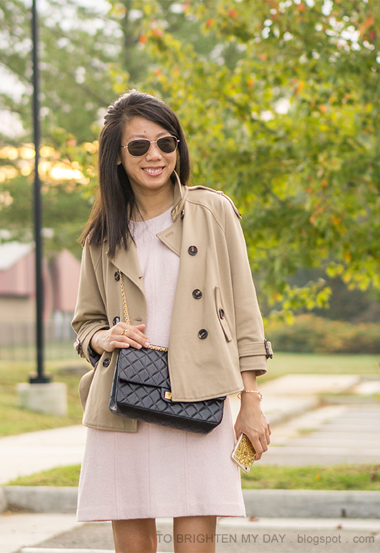 camel trench cape, pink wool shift dress, black crossbody bag