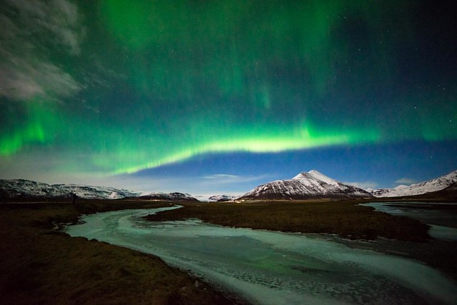 The holidays are here, so this week I'm sharing images of nature's light show. The Northern Lights over a frozen river outside Höfn, Iceland.