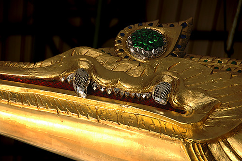 The golden head adorns a royal dragon boat in Bangkok, Thailand