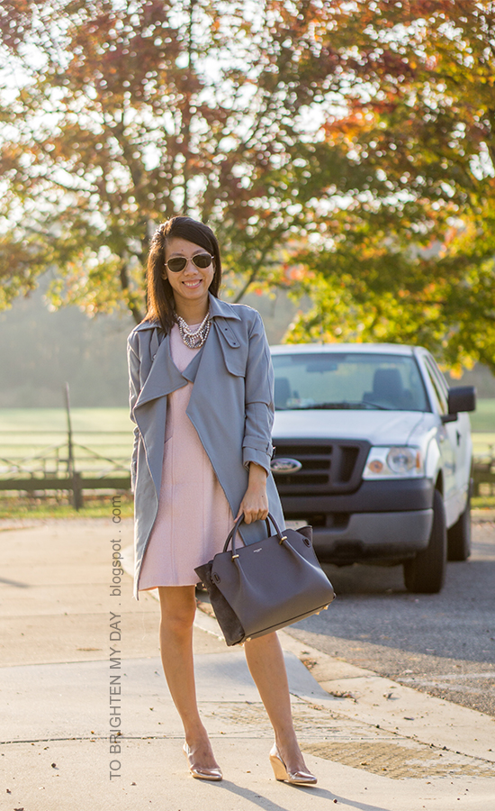 gray blue drape trench, pink sleeveless shift dress, pearlized statement necklace, gray tote, rose gold wedges