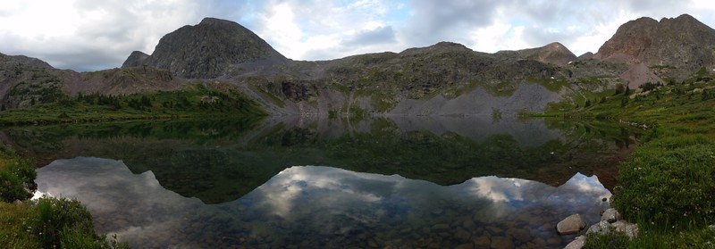 Panorama dawn reflection on Rock Lake, the pass in the center and Peters Peak on the far right.