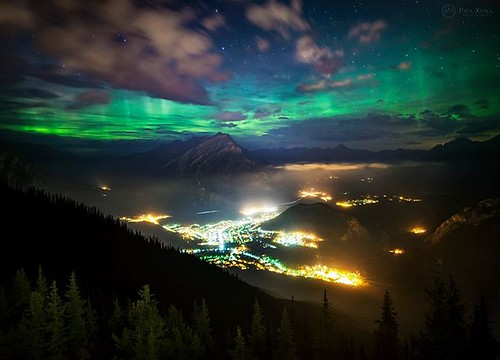 """Aurora Over Banff"" The northern lights have a way of renewing a scene we've gazed at a hundred times... Our little town of Banff rests beneath the dancing curtains of the aurora borealis. Brewster Travel Canada"