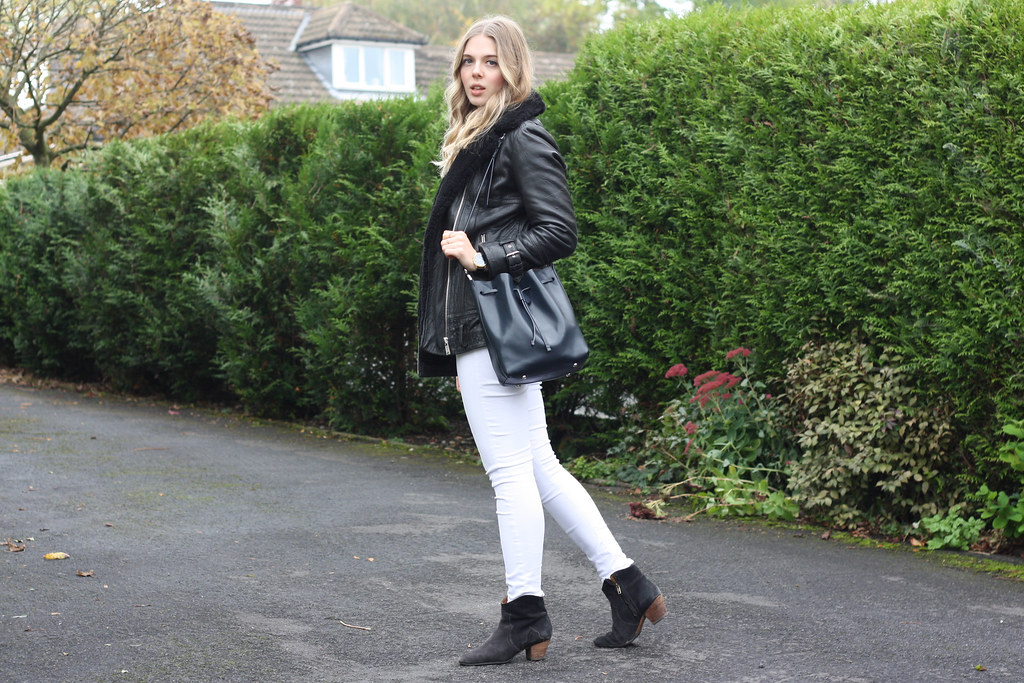 Topshop skinny white jeans, Whistles black sheepskin coat and Larsson & Jennings black leather watch