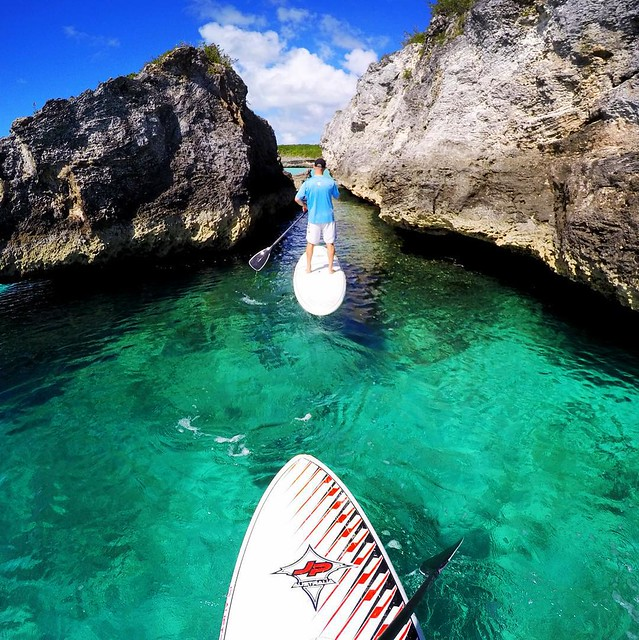 Exploring the sea cliffs of Eleuthera by paddle board. @TheCove_Eleuthera in #Bahamas - #SUP #Paradise #Honeymoon #Ocean