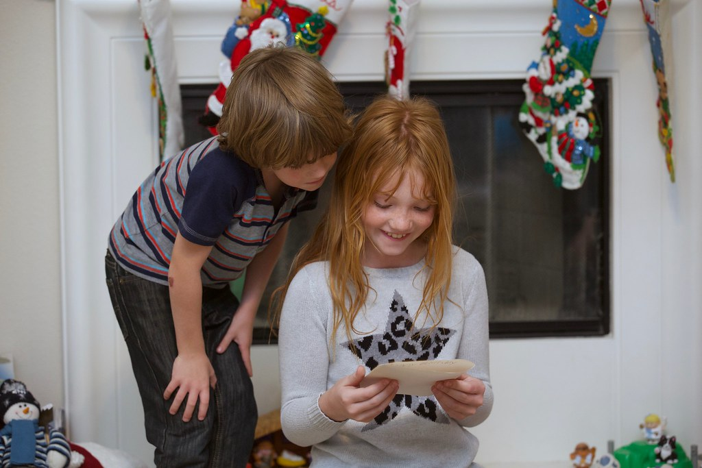 watching his sister open presents