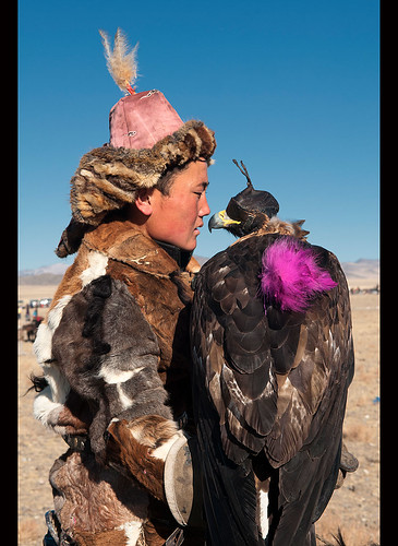 Kazakh eagle hunter and his golden eagle in the Altai Region of Bayan-Ölgii in Western Mongolia | by jitenshaman