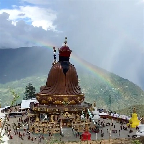 An auspicious rainbow crowns the statue of Guru Rinpoche in Takila during the empowerments From Dzongsarjamyangkhyentsefanclub Facebook