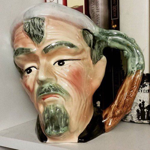 Toby mug IV: No idea who he is, either, but he was marked 'as is' and sold for two bucks. He has a tiny crack in his crown, but as I'm not using these for liquid distribution, I thought I'd give him a bookshelf to hang out on for two bucks. Something abou