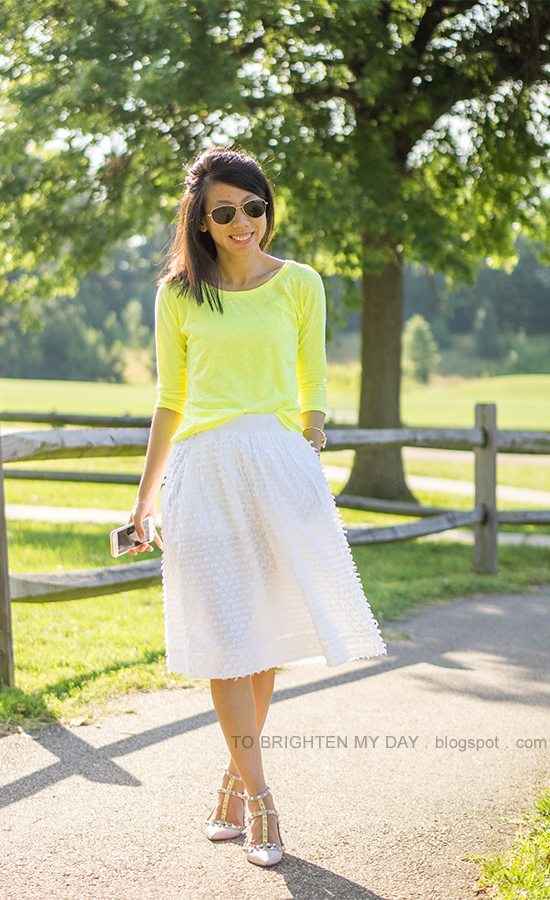 neon yellow top, white clip dot midi skirt, watercolor studded flats