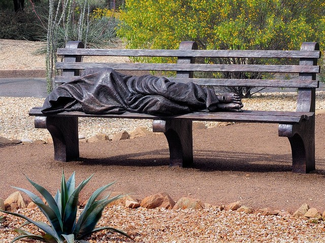 Homeless Jesus on bench