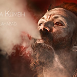An Ash Smeared Naga Sadhu Smoking Pot