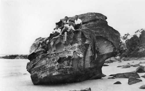 Group of men sitting on Skull Rock, Moreton Island, ca. 1920 | by State Library of Queensland, Australia