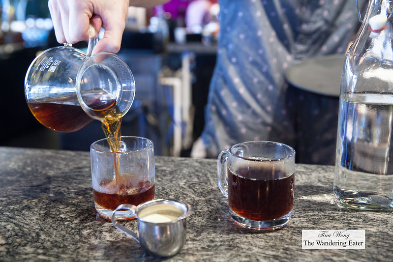 Pouring our Kalita-brewed Papua New Guinea coffee
