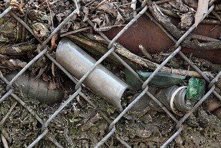 Buried trash behind chain-link fence, Elmhurst, Queens | by Eating In Translation