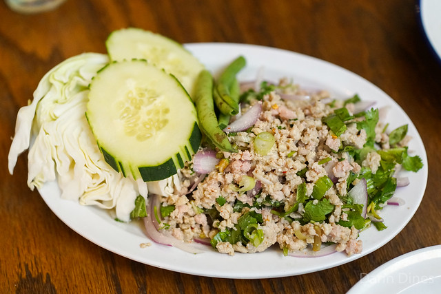 larb gai minced chicken, lime, fish sauce, rice powder, chile, cilantro, onion