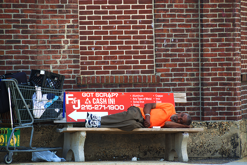 Older homeless man on bench on 6-26-16--Pennsport