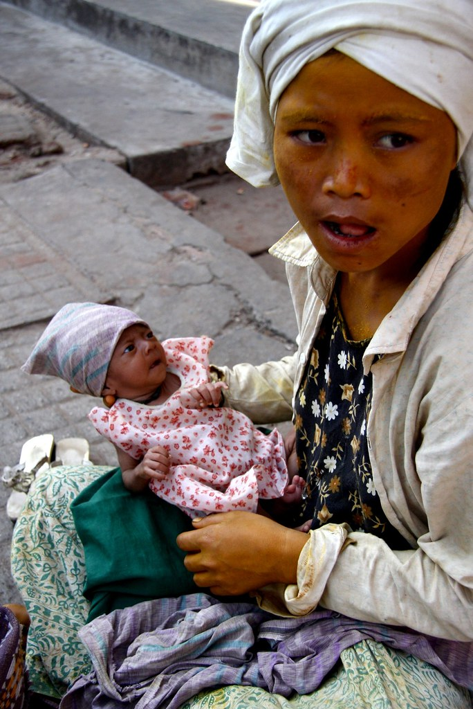 A Young Mother Begging In Yangon