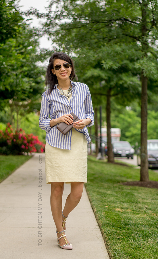 pearl cluster necklace, blue striped button up shirt, pale yellow shift dress, taupe clutch, watercolor studded flats