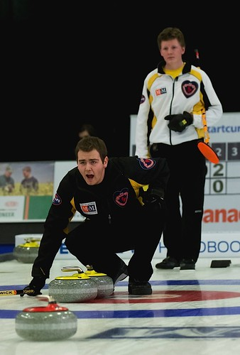 New Brunswick skip Rene Comeau reacts as Manitoba skip Braden Calvert looks on during the men's final. | by seasonofchampions