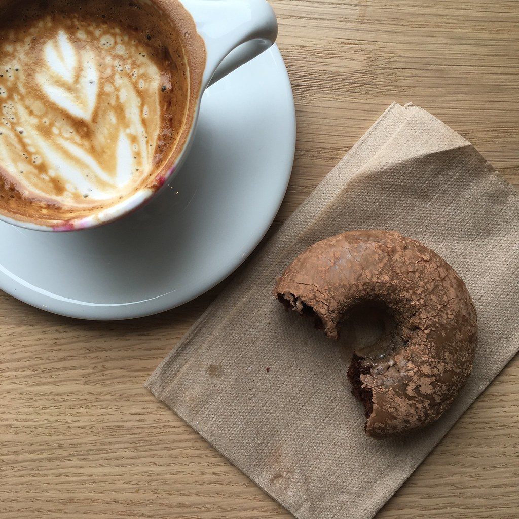 Eating Back to Eden chocolate-rootbeer doughnut with Upper Left Roasters coffee