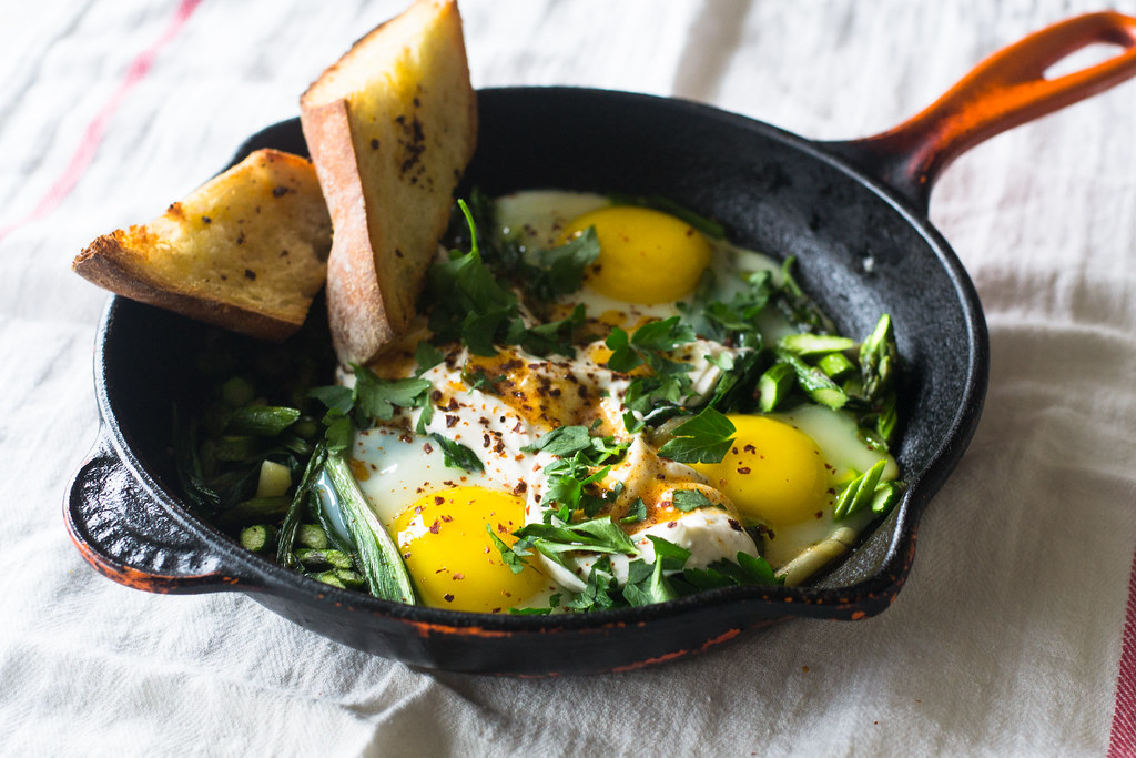 Spring Shakshuka with Ramps, Herbed Yogurt and Spiced Butter