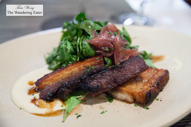 Thyme roasted pork belly, arugula salad and caramelized red onions