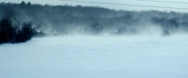 Blowing snow on the river