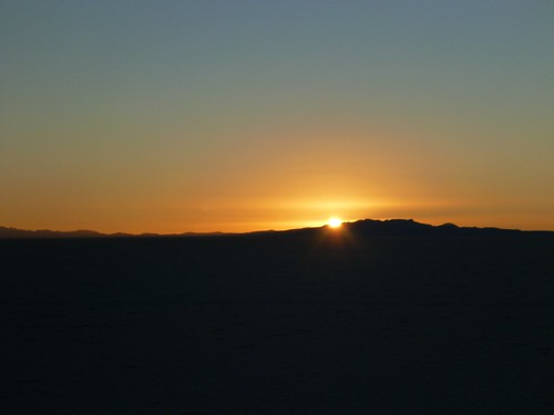 Sun rising over a mountain