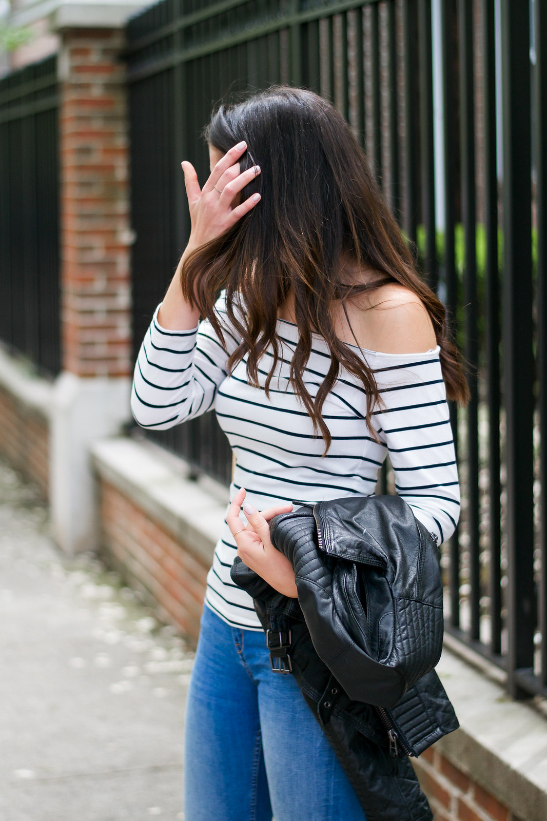 Striped top and leather jacket
