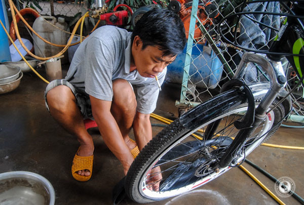 Fixing a Flat Bike Tire In Vietnam.jpg
