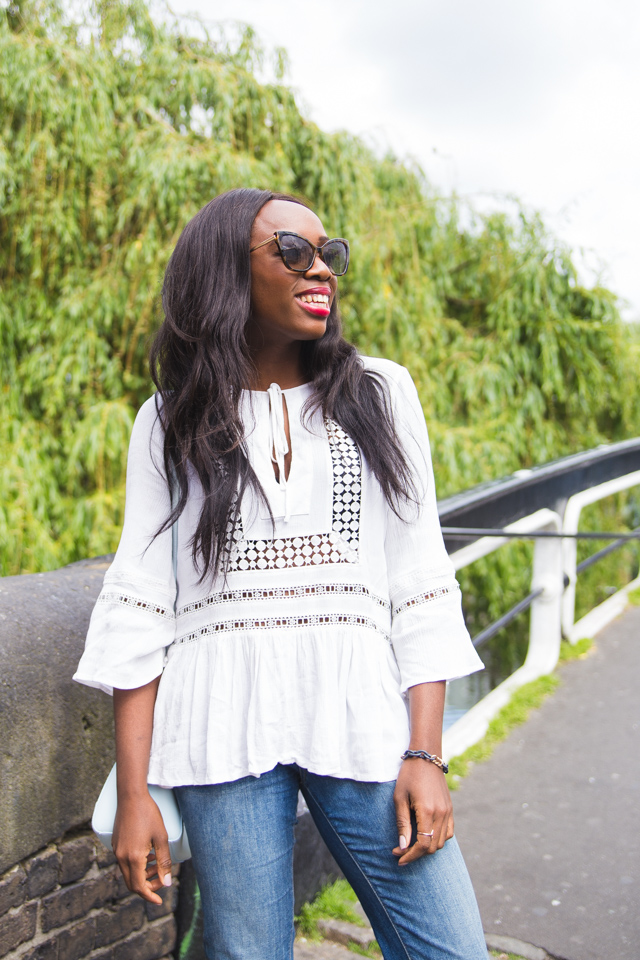 styling a boho frill top with cut off jeans