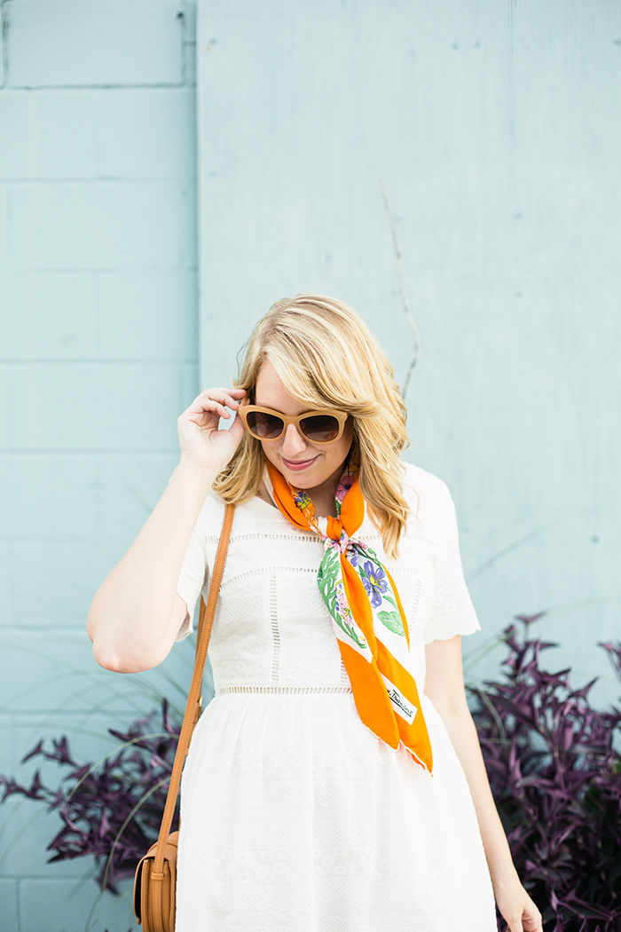 get a vintage look with cream sunglasses and a silk scarf